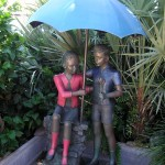 statues under an umbrella